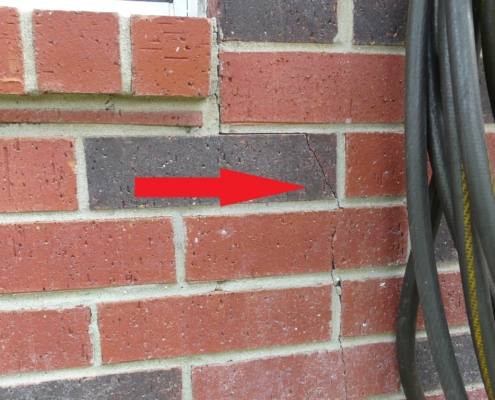 Crack in brick veneer due to minor foundation settlement